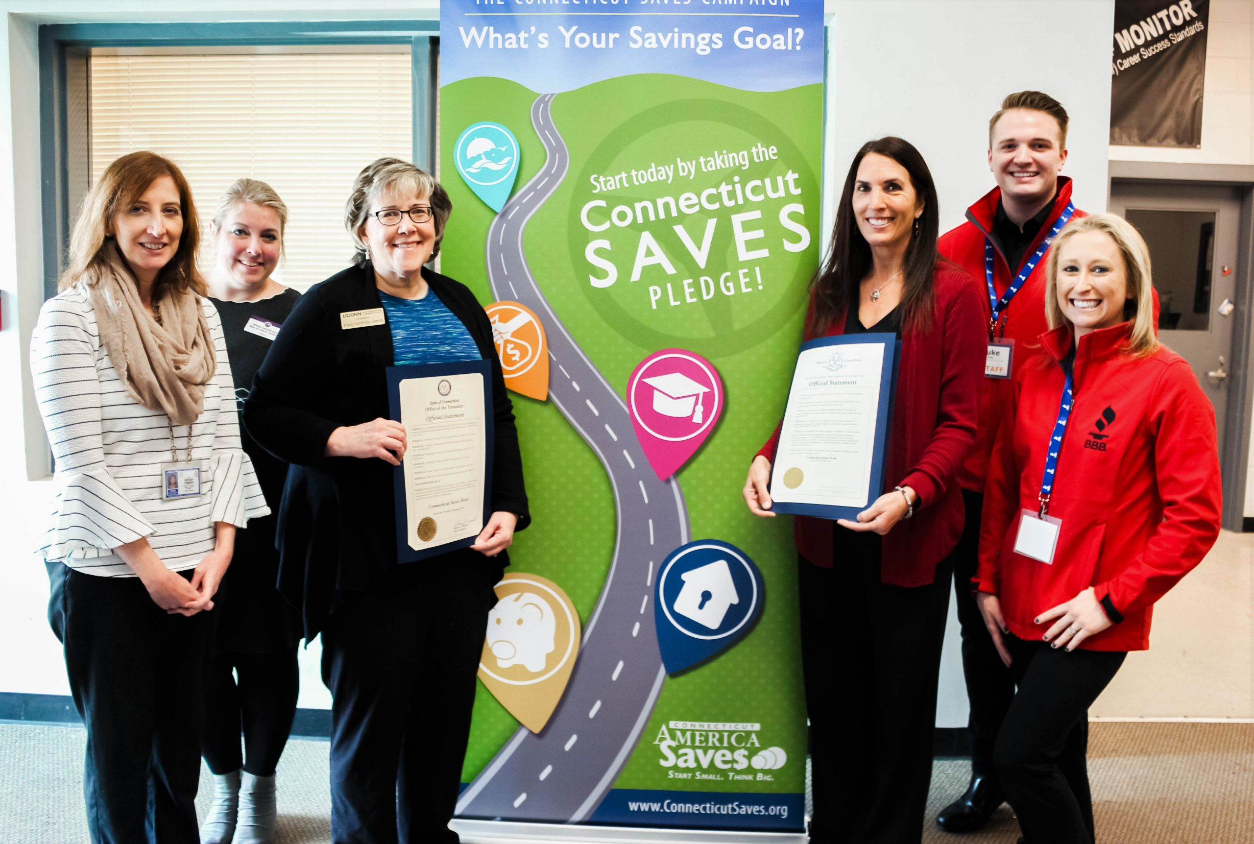 members of the Connecticut Saves team at the Hartford Jobs Academy with the Connecticut Saves proclamation